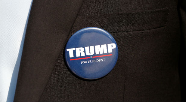 A member of the U.S. Republican party's election campaign team in Israel wears a badge of Republican U.S. presidential nominee Donald Trump during a campaign aimed at potential American voters living in Israel. (REUTERS/Baz Ratner)