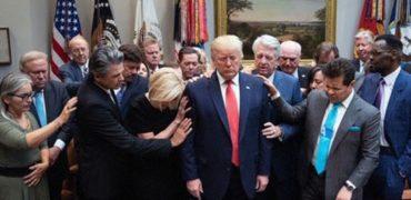 faith leaders pray over President Donald Trump